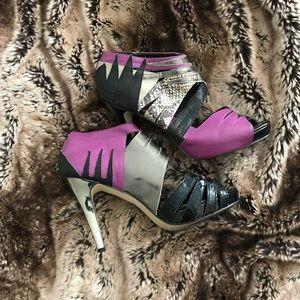 Snake print. Silver. Purple. Black. Heels